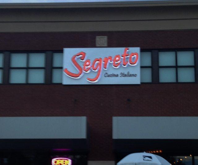 A back-lit channel letter sign for Segreto Cucina Italiano