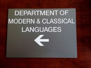 directional sign with raised lettering and braille