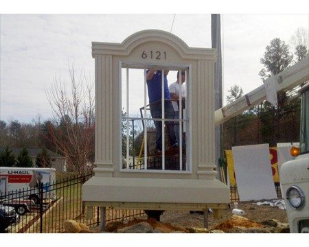 sign installation of a marquee monument sign