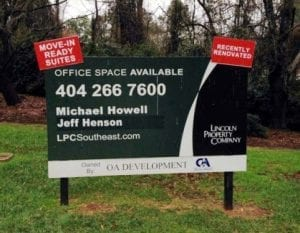 A post and panel sign that was updated with other signage for Lincoln Properties