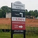A wayfinding sign for Ponderosa Farms