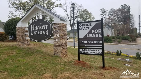 "Hackett Crossing ""For Lease"" post and panel sign"