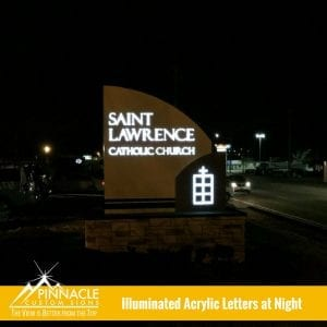 The view at night of the new lighted monument sign for Saint Lawrence Catholic Church