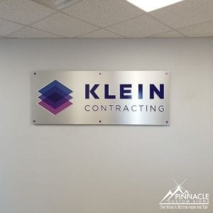 Brushed aluminum sign with acrylic and vinyl lettering