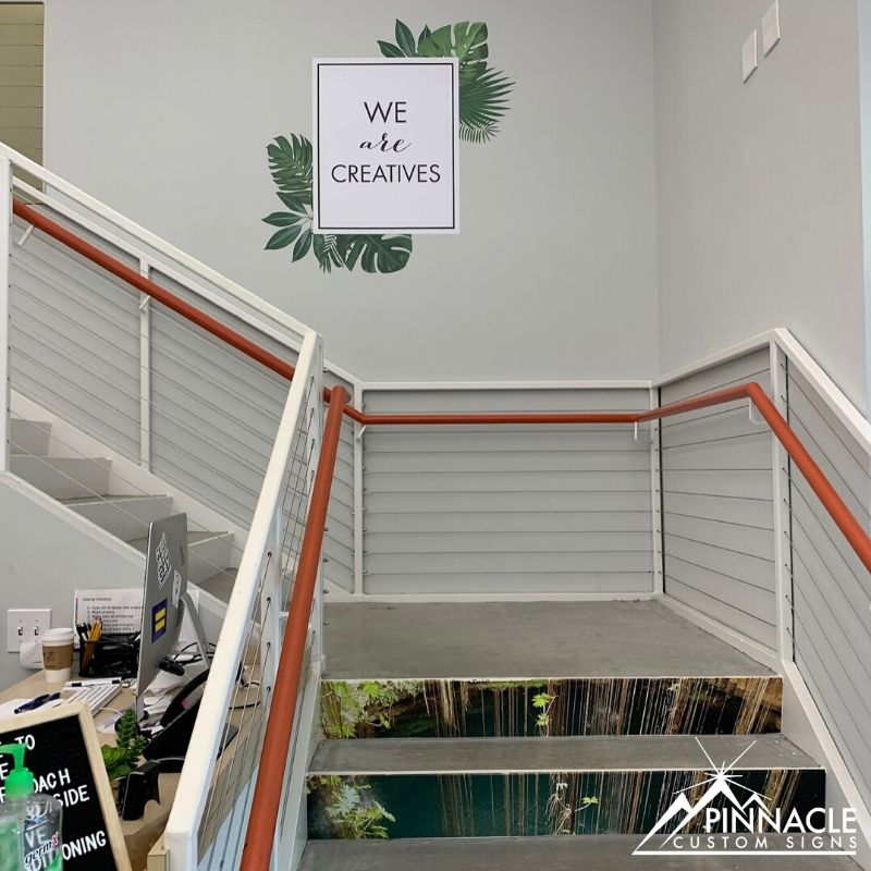 custom office signage on stairs